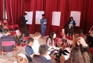 Courtney (in the middle) facilitates a workshop